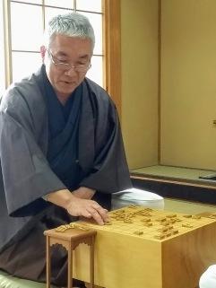 article 35-photo 6-27 01 2019_shogi_the senior player taking a koma